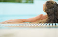 Young woman enjoying pool rear view with long hair Royalty Free Stock Photography