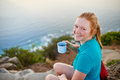 Young woman enjoying some coffee on a morning hike Royalty Free Stock Photo