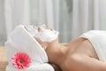 A young woman enjoying spa mask women facial at salon indoors Stock Photos