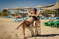 Young woman enjoying sun at the beach slim redhair in egypt Royalty Free Stock Photo