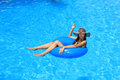 Young woman enjoying the swimming pool in summertime Stock Photo