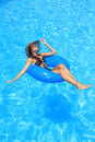 Young woman enjoying the swimming pool in summertime Royalty Free Stock Image