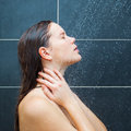 Young woman enjoying under shower Royalty Free Stock Photo