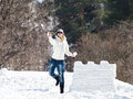 Young woman enjoying winter and playing with snow outdoor Royalty Free Stock Image