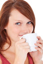 Young woman enjoys cup of coffee attractive all on white background Stock Photography