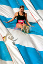 Young Woman Enjoys Going Down Slide In Obstacle Race Royalty Free Stock Photo