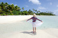 Young woman enjoys the serenity of a deserted tropical island in aitutaki lagoon cook islands Royalty Free Stock Image