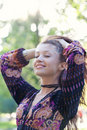 Young woman enjoys sun beams in park Royalty Free Stock Photo