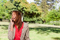 Young woman enthusiastically laughing while on the phone in an o Royalty Free Stock Photo