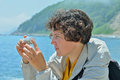 Young woman entomologist the at sea Stock Image