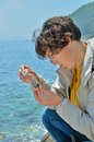 Young woman entomologist the at sea Royalty Free Stock Images