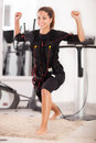 Young woman exercise on electro stimulation machine Royalty Free Stock Photo