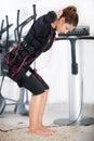 Young woman exercise on electro stimulation machine Royalty Free Stock Photo