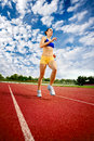 Young woman exercise jogging and running beautiful on athletic track Stock Photo