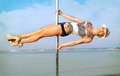 Young woman exercise pole dance slim outdoors Stock Photos