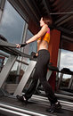 Young woman exercise on treadmill Stock Photo