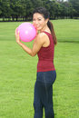 Young woman exercised with pink ball in the garden Stock Photos
