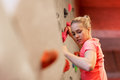 Young woman exercising at indoor climbing gym Royalty Free Stock Photo