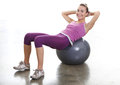 Young woman exercising with large ball training athletic in the gym Royalty Free Stock Photo
