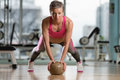 Young Woman Exercising Push Ups On Medicine Ball Royalty Free Stock Photo