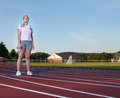 Young woman exercising on a track outdoors Royalty Free Stock Photo