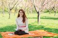 Young woman with eyeglasses reading in the park Stock Photo