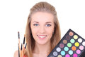 Young woman with eyeshadow makeup palette Royalty Free Stock Photo