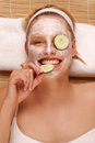 A young woman with a face pack. Royalty Free Stock Photo