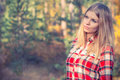 Young woman face portrait blonde hair outdoor with forest nature on background Stock Photography