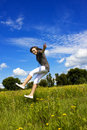 Young woman falls in the air on a flower meadow Stock Images