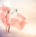Young woman on fantasy clouds with antique lamp Royalty Free Stock Photo