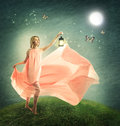 Young woman on a fantasy hilltop grassy with antique lamp Royalty Free Stock Photos