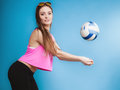 Young woman fashion girl with ball on blue background Royalty Free Stock Photo