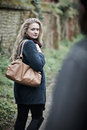 Young woman feeling threatened as she walks home Royalty Free Stock Images