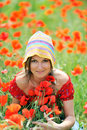 Young woman on field with poppies Royalty Free Stock Photo