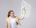 Young woman finding the maze solution, writing on whiteboard. Royalty Free Stock Photo