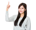 Young woman with finger pointing upwards Royalty Free Stock Photo