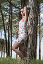Young woman in a floral tight and short dress view of posing nature Royalty Free Stock Photography