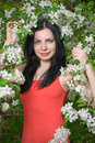 Young woman in flowers Royalty Free Stock Image
