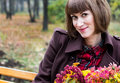 Young woman with flowers in autumn park Royalty Free Stock Photo