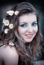 Young woman with flowers in hair Royalty Free Stock Image