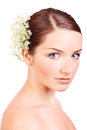 Young woman with flowers in her hair Stock Photography