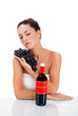 Young woman and fresh grapes a holding on the table bottle of wine Royalty Free Stock Photos