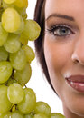 Young woman and fresh grapes portrait of green Royalty Free Stock Images