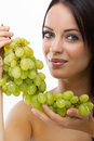 Young woman and fresh grapes portrait of green Stock Photography
