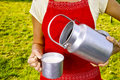Young woman with fresh organic farm cowmilk in aluminum milk can Royalty Free Stock Photo