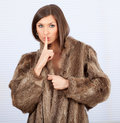 Young woman in a fur coat Stock Images