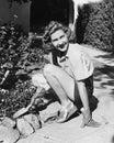 Young woman in a garden doing gardening