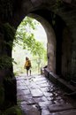 Young woman and the gate of ancient city wall walking in which in hechuan district chongqing china Royalty Free Stock Photo