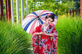 Young woman in geisha costume with an umbrella Royalty Free Stock Photo